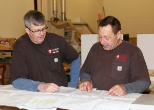 Roy Clarkson and Brian Purick review plans for their next project.