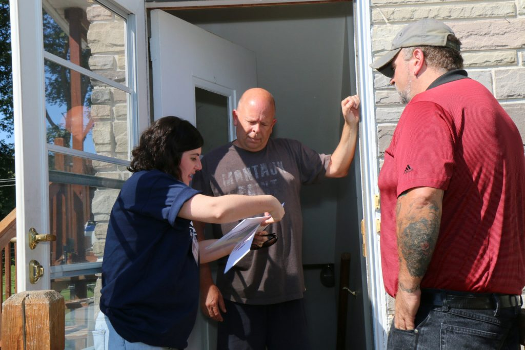 CSEA Attorney Jennifer Zegarelli, left, and Otsego County Local 839 President Tim Backus, right, talk with member Jeffry Carr at his Endicott home.