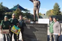 Workers at Roberto Clemente State Park stand with the monument to the baseball great and humanitarian.