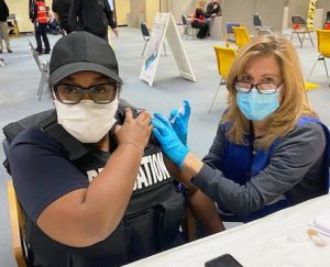 Orange County Unit member Tisa Hanshaw, a probation officer, receives the COVID-19 vaccine at a vaccine clinic coordinated by the Orange County Department of Health. (Photo provided by Yolanda Perez and Pam Cole.)